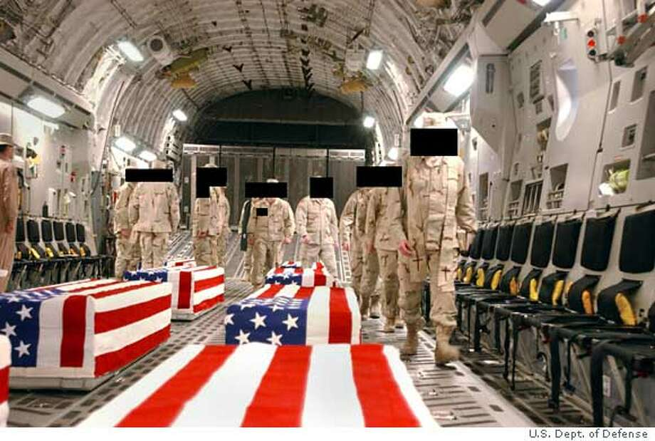 UNDATED: Caskets bearing the remains of U.S. servicemen are shown in the cargo hold of a transport plane in this undated handout photo released April 28, 2005 by the Pentagon. The release this week of more than 700 images showing the return of American casualties to Dover Air Force Base and other U.S. military facilities follows Freedom of Information Act requests and a lawsuit charging the Pentagon with failing to comply with the act. The military digitally concealed faces and other identifying marks. (Photo by U.S. Department of Defense/The National Security Archive via Getty Images) Ran on: 04-29-2005  This undated photo released by the Pentagon shows a transport plane carrying caskets with the remains of U.S. soldiers killed in Iraq. Ran on: 04-29-2005  This undated photo released by the Pentagon shows a transport plane carrying caskets with the remains of U.S. soldiers killed in Iraq. Photo: DOD