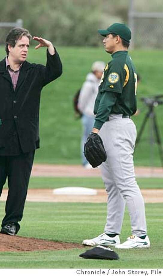 022005_Athletics_jrs750.JPG  Interpreter Andy Painter explains things to pitcher Keiichi Yabu on the first day of spring training.  The Oakland A's first day of Spring Training in Phoenix. Event on 2/20/05 in Phoenix. John Storey / The Chronicle MANDATORY CREDIT FOR PHOTOG AND SF CHRONICLE/ -MAGS OUT Photo: John Storey