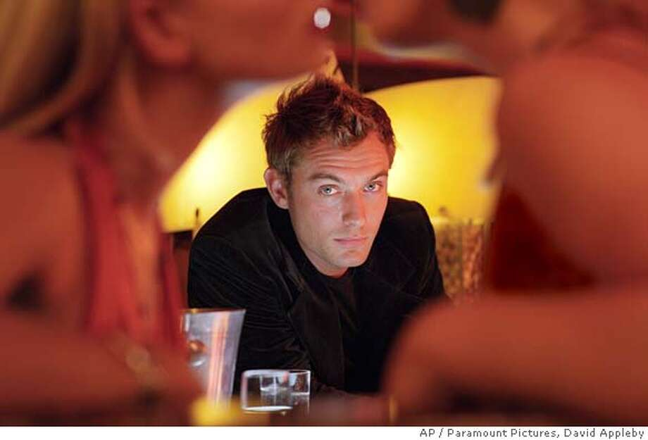 """Actor Jude Law appears in a scene from his new film """"Alfie,"""" in this undated production photo. With """"Alfie,"""" Law has roles in six new movies released during the last four months of 2004. (AP Photo/Paramount Pictures, David Appleby) Datebook#Datebook#Chronicle#11/05/2004##Advance##0422431353 Photo: DAVID APPLEBY"""