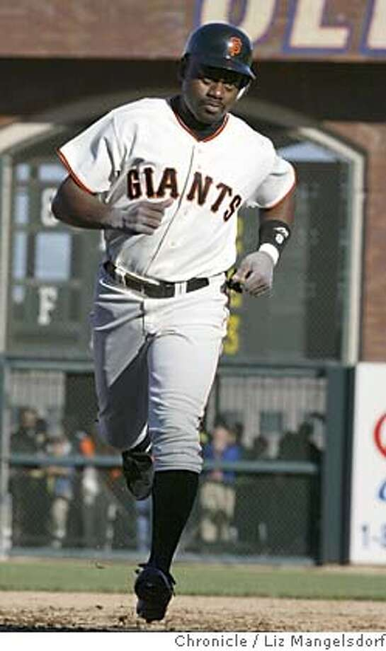 giants387_lm.JPG Event on 6/24/04 in San Francisco.  Giant Marquis Grissom rounds the bases after his two-run homerun.  Giants beat the LA Dodgers to sweep the Dodgers in four games at SBC Park.  Liz Mangelsdorf / The Chronicle MANDATORY CREDIT FOR PHOTOG AND SF CHRONICLE/ -MAGS OUT Sports#Sports#Chronicle#11/4/2004#ALL#5star##0422164548 Photo: Liz Mangelsdorf
