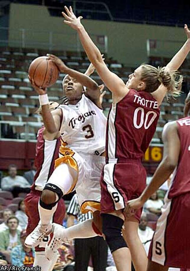 Southern California's Rometra Craig (3) draws a foul from Stanford's Chelsea Trotter (00) in the first half Sunday, Jan. 26, 2003, at the Los Angeles Sports Arena. (AP Photo/Ric Francis) Photo: RIC FRANCIS