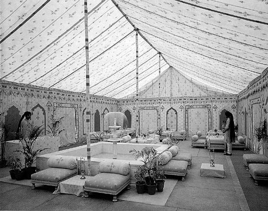 EBLTENT.JPG One of the tents from Raj Tents in Oakland. HO Ran on: 11-05-2004  Tents from Raj Tents create a flavor of the East with pavilions that include patterned ceilings. Ran on: 11-05-2004  Tents from Raj Tents create a flavor of the East with pavilions that include patterned ceilings.