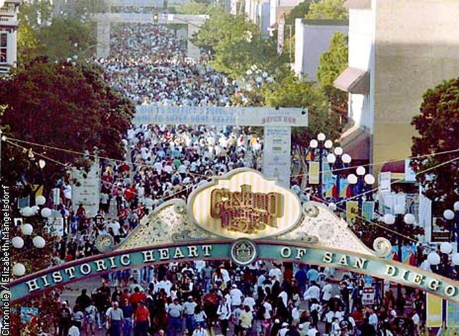SUPERBOWL1-C-25JAN03-MT-LM  Fifth Avenue, in the Gaslamp Quarter of San Diego is filled with thousands of people on the day before the super bowl.  Photo By Liz Mangelsdorf Photo: Liz Mangelsdorf