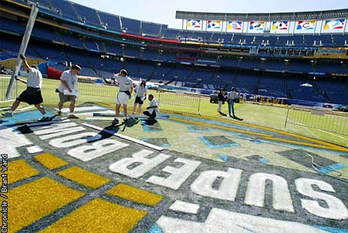 A field painting crew made finishing touches on the huge Super Bowl patch in the middle of Qualcomm Stadium in San Diego...making it all ready for the Super Bowl Sunday. By Brant Ward/Chronicle
