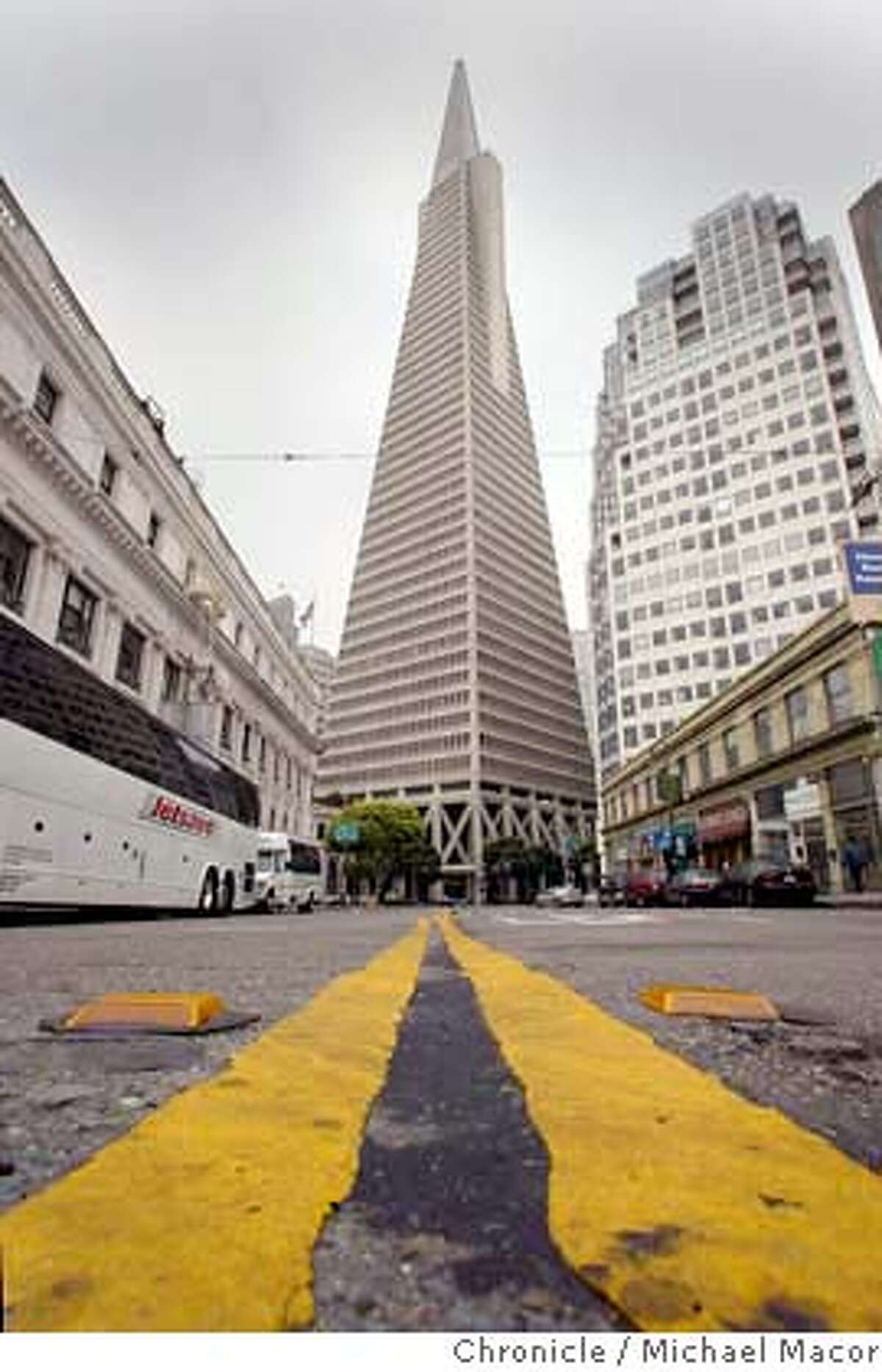 transamerica170_mac.jpg A view from the middle of Columbus Ave. The Transamerica Pyramid, a San Francisco icon. event on 5/26/04 in San Francisco Michael Macor / San Francisco Chronicle Above: San Francisco's iconic Transamerica Pyramid is viewed from the middle of Columbus Ave. Top: Utility engineer Rafael Ramirez inspects the Pyramid's crown jewel, a 6,000-watt halogen beacon that can be seen throughout the Bay Area. Above: San Francisco's iconic Transamerica Pyramid is viewed from the middle of Columbus Street. Top: Utility engineer Rafael Ramirez inspects the Pyramid's crown jewel, a 6,000-watt halogen beacon that can be seen throughout the Bay Area. The Transamerica Pyramid as seen from the middle of Columbus Avenue in San Francisco. Mandatory Credit For Photographer and SF Chronicle/ - Magazines Out Datebook#Datebook#Chronicle#11/04/2004#ALL#Advance##0421786856