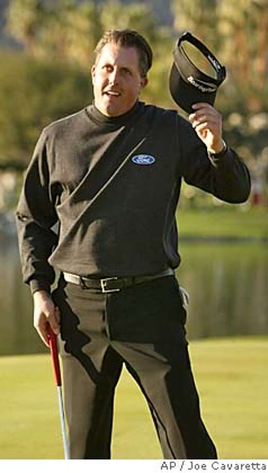Phil Mickelson reacts after sinking a three-foot birdie putt in a playoff with Skip Kendall to win Sunday, Jan 25, 2004 at the PGA West in La Quinta, Calif., during the final round of the Bob Hope Chrysler tournament. (AP Photo/Joe Cavaretta) Phil Mickelson acknowledges the gallery after winning his first tournament in a year and a half. He also won the Hope in 2002. Phil Mickelson acknowledges the gallery after winning his first tournament in a year and a half. He also won the Hope in 2002. Sports#Sports#Chronicle#11/4/2004#ALL#5star##0421586459 Photo: JOE CAVARETTA
