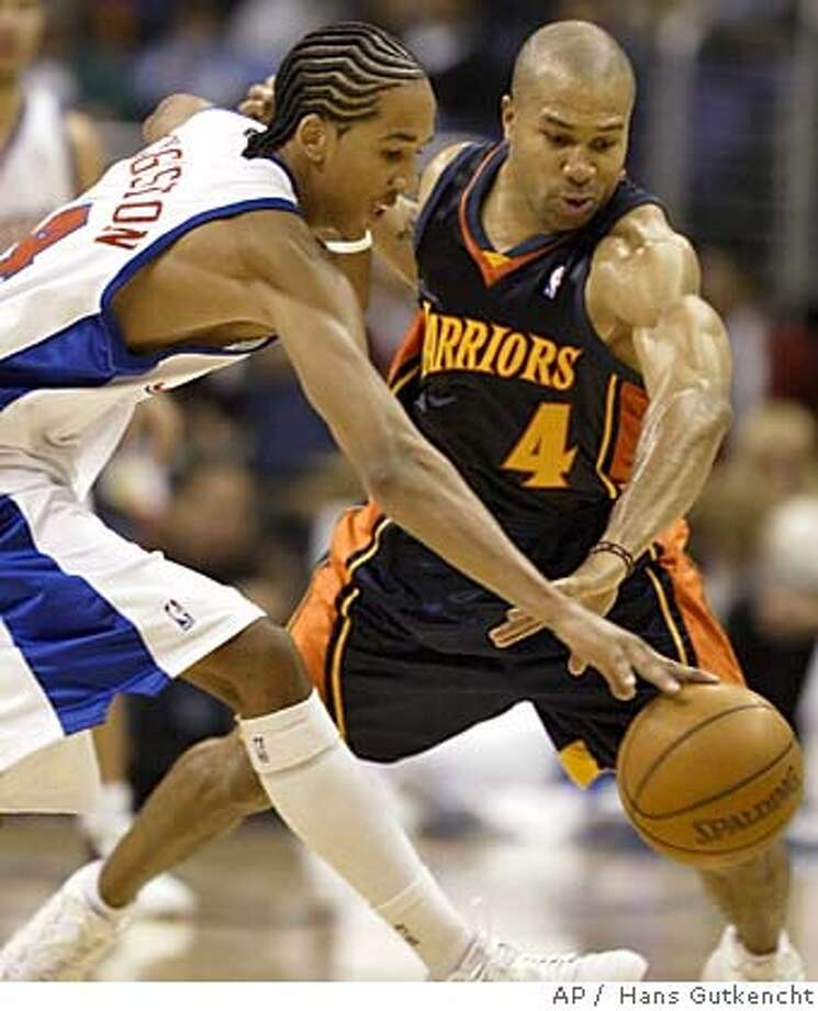 Golden State Warriors' Derek Fisher, left, pokes the ball away from Los Angeles Clippers' Shaun Livingston during the first half of a preseason game in Los Angeles Tuesday, Oct. 19, 2004..( AP Photo/LA Daily News, Hans Gutkencht) , MAGS OUT, LA TIMES OUT VENTURA COUNTY STAR OUT Sports#Sports#Chronicle#11/3/2004#ALL#5star##0422422392 Photo: HANS GUTKENCHT