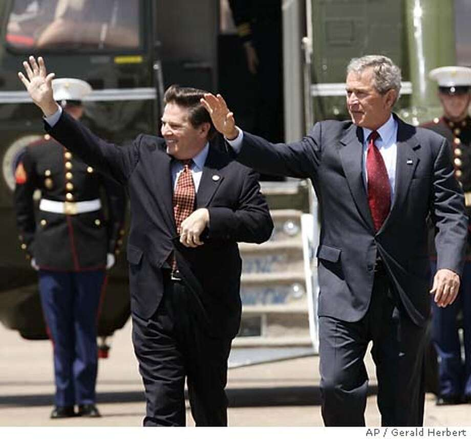 President Bush and House Speaker Tom DeLay, R-Tex, prepare to depart from Ellington Field in Houston, Texas, Tuesday, Apr. 26, 2005. The preseident invited DeLay to accompany him to Texas to participate in a Social Security event and opened up his remarks by saying he had strong confidence in DeLay's leadership on Capitol Hill. (AP Photo/Gerald Herbert) Photo: GERALD HERBERT