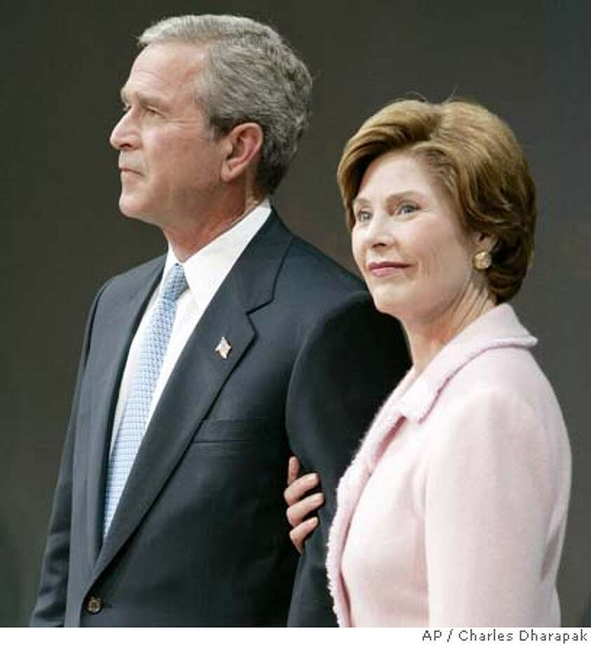 President Bush and first lady Laura Bush stand on stage during a victory rally Wednesday, Nov. 3, 2004, at the Ronald Reagan Building and International Trade Center in Washington. (AP Photo/Charles Dharapak) Photo: CHARLES DHARAPAK