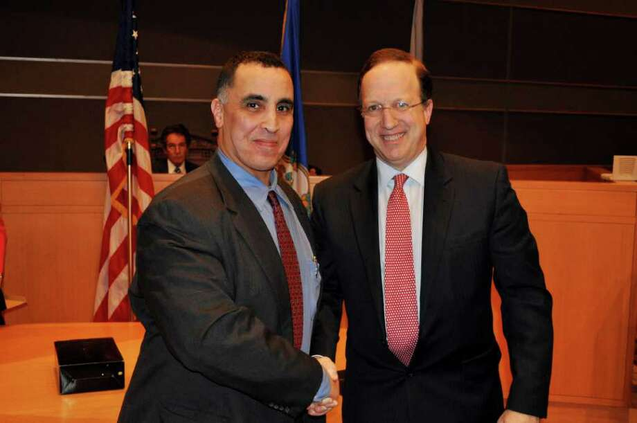 U.S. Immigration and Customs Enforcement Special Agent Rod Khattabi is congratulated by U.S. Attorney David Fein after receiving an award for Exceptional Contributions in Law Enforcement by exposing sex trafficking cases in Fairfield County and sexual abuse committed by U.S. citizens in humanitarian programs in Haiti and South Africa. Photo: Contributed Photo / Connecticut Post Contributed