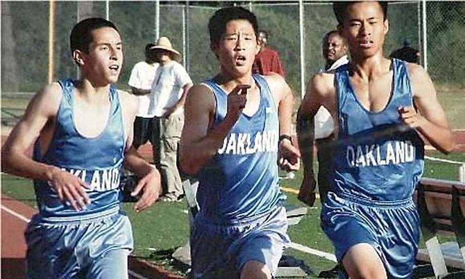 Photo of three Oakland High cross country runners from left to right: Thomas Dileo, Albert Chan and Benison Ying.