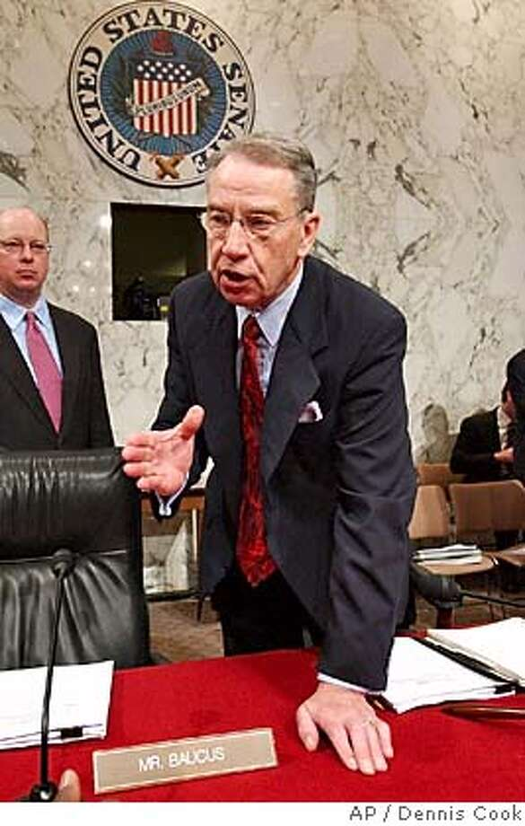 Senate Finance Committee Chairman Sen. Charles Grassley, R-Iowa, talks to reporters on Capitol Hill Tuesday, April 26, 2005, prior to a hearing on overhauling Social Security. (AP Photo/Dennis Cook) Photo: DENNIS COOK