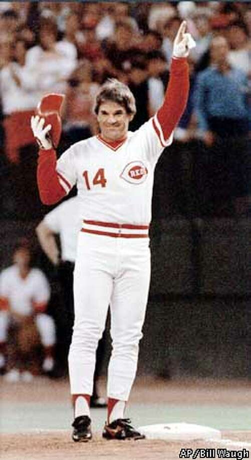 FILE-- Cincinnati Reds Pete Rose signals he's #1 after connecting for his 4,192nd career base hit to break Ty Cobb's all-time record, in this Sept. 11, 1985, in Cincinnati. By a 2-1 margin, most people think Rose should be reinstated by baseball, even though 40 percent believe he did gamble on his sport, according to an Associated Press poll.(AP Photo/Bill Waugh)