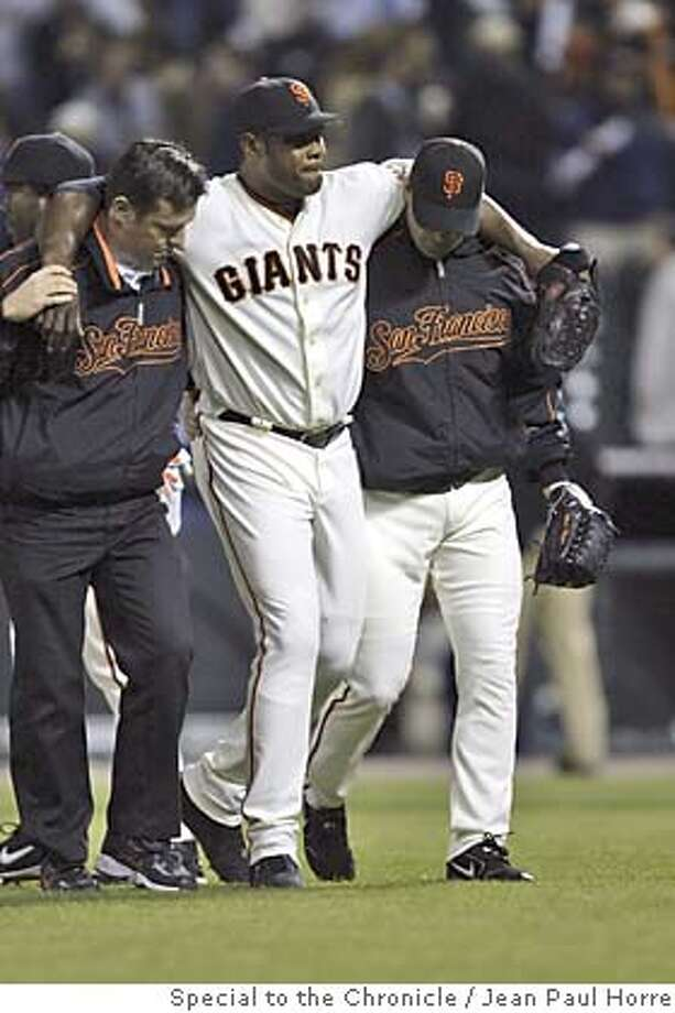 GIANTS_001_JPH.JPG  Giants closer, Armando Benitez is helped off the field by team trainers after apparently injuring himself on the last out of the game. The San Francisco Giants played the San Diego Padres at SBC Park, in San Francisco, Ca., on Tuesday, April 26, 2005.  Photo by Jean Paul Horre / The San Francisco Chronicle  Photo taken on 4/26/05 in San Francisco, CA. MANDATORY CREDIT FOR PHOTOG AND SAN FRANCISCO CHRONICLE/ -MAGS OUT Photo: Special To The Chronicle / Jean