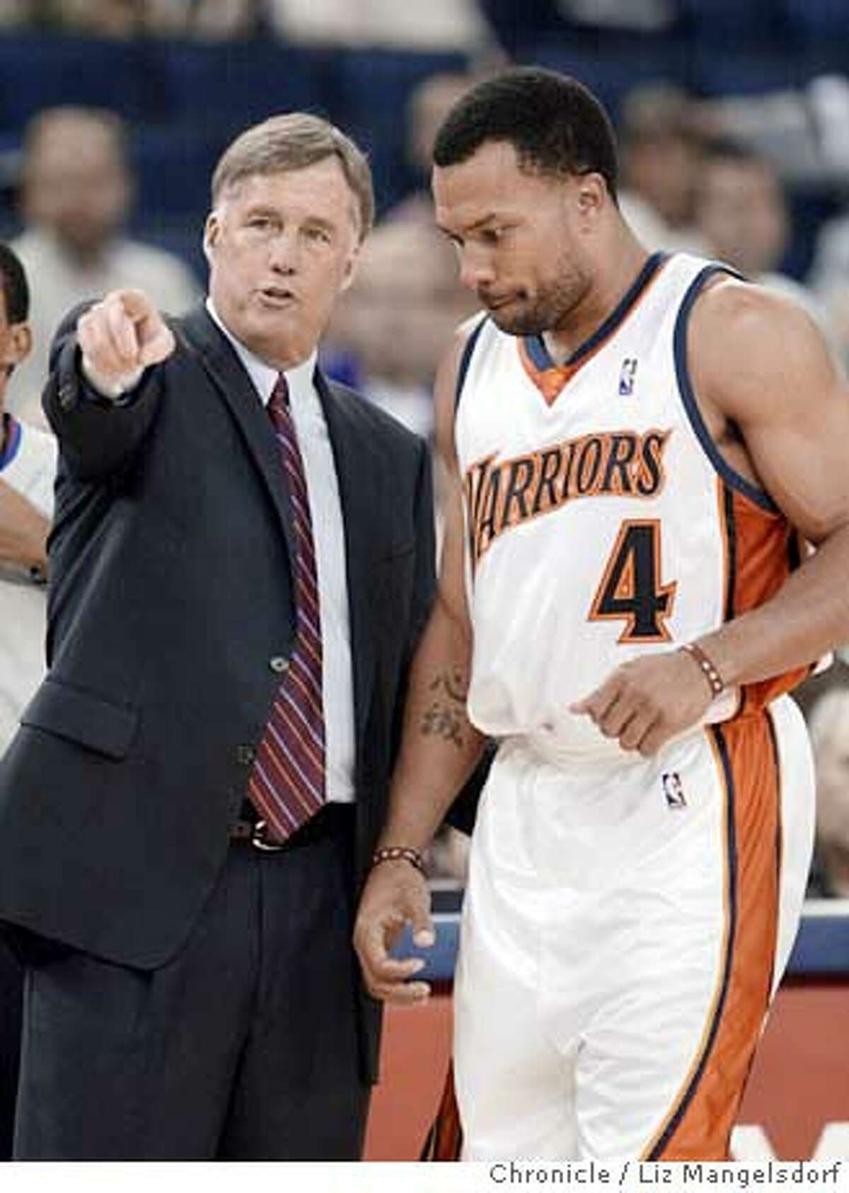 46FB0274.JPG Event on 10/14/04 in Oakland. warrior new head coach Mike Montgomery talks with Derek Fisher during a break in the action in the 2nd quarter. Golden State Warriors v Portland Trailblazers in preseason action at the Oakland Coliseum. Liz Mangelsdorf / The Chronicle