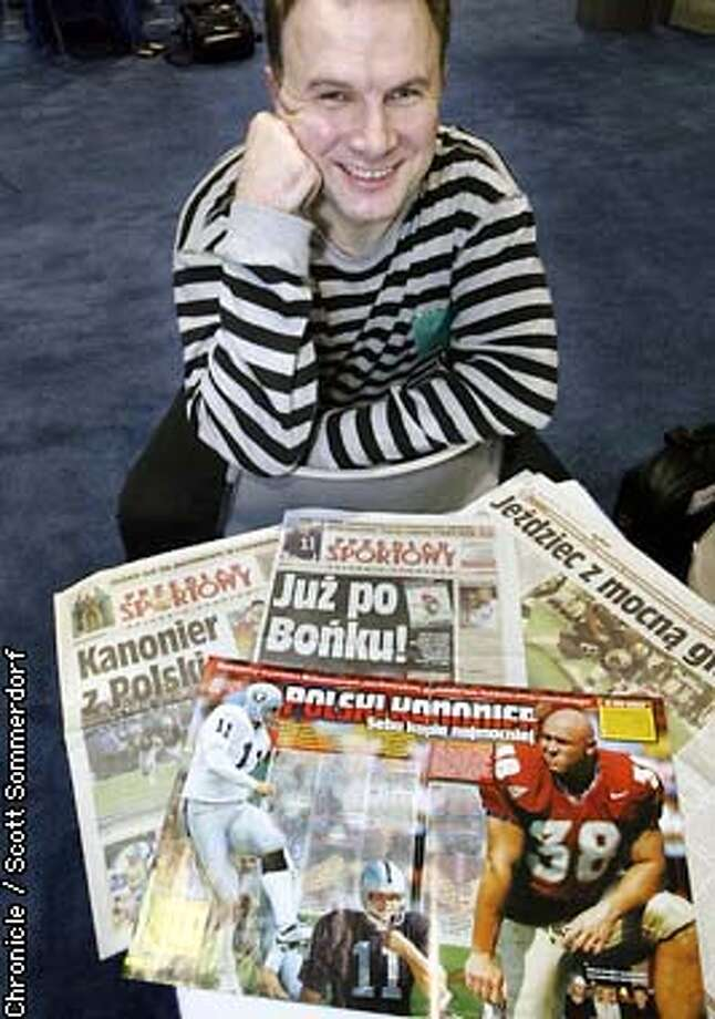 Polish sports journalist Chris Reiko with some of the reporting that he and his partner Anna Kamienski have done on Raiders kicker and Polish native Sebastian Janikowski. SCOTT SOMMERDORF / San Francisco Chronicle Photo: Scott Sommerdorf