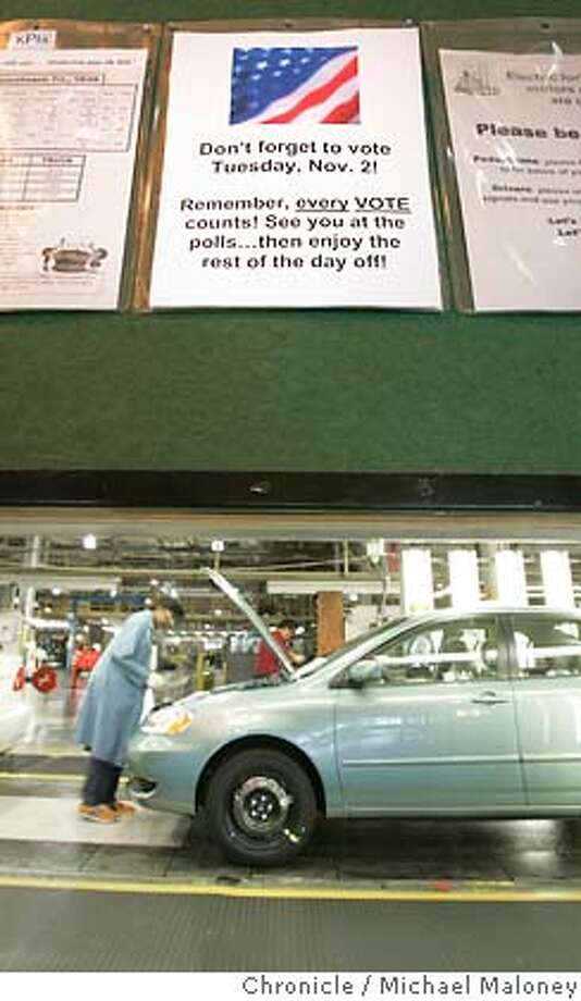 "BIZVOTE02_022_MJM.jpg  A sign on a bulletin board near the assembly line urges the NUMMI employees to vote.  The NUMMI auto plant in Fremont closes tomorrow, election day for the whole day, giving all its 5,700 employees the day off to vote, under a collective bargaining agreement with the United Auto Workers (managers get the day off too). They have signs up saying ""Remember to vote"" throughout the plant.  Photo by Michael Maloney / San Francisco Chronicle MANDATORY CREDIT FOR PHOTOG AND SF CHRONICLE/ -MAGS OUT Business#Business#Chronicle#11/2/2004#ALL#5star##0422444542 Photo: Michael Maloney"