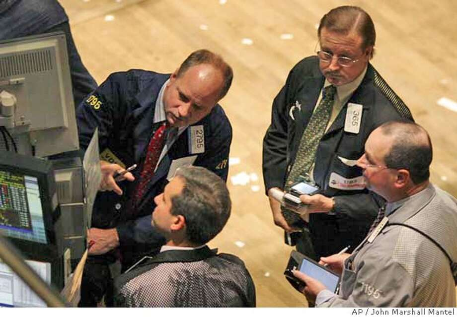 Traders follow closing bell equity prices at the New York Stock Exchange, on election day, Tuesday, Nov. 2, 2004. The Dow ended the session down after advancing earlier in the day. (AP Photo/John Marshall Mantel) Business#Business#Chronicle#11/3/2004#ALL#5star##0422446509 Photo: JOHN MARSHALL MANTEL