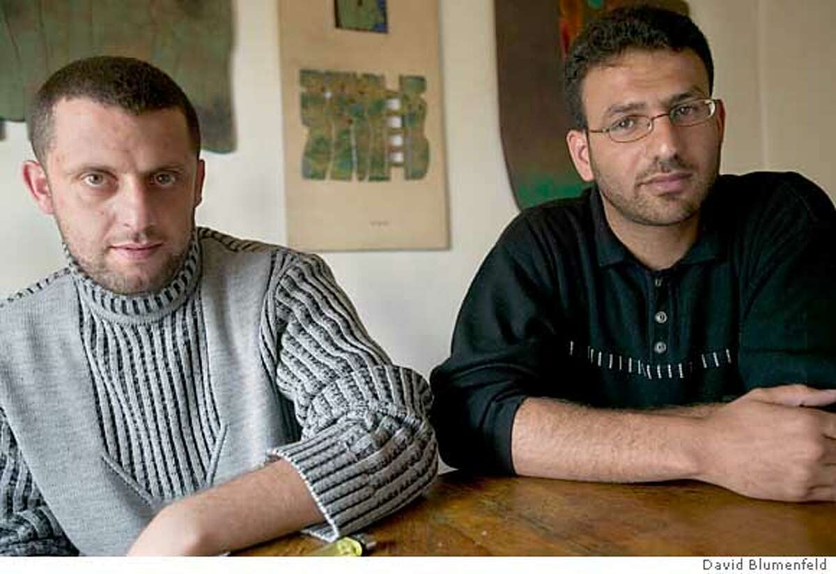 Ramallah, West Bank: 04/18/2005: Munif Remawi, 27 (left) and Mahmoud Remawi, 26 (right) two of the Al Aqsa Martyrs Brigade wanted by Israel who were recently kicked out of the Mukata. �David Blumenfeld