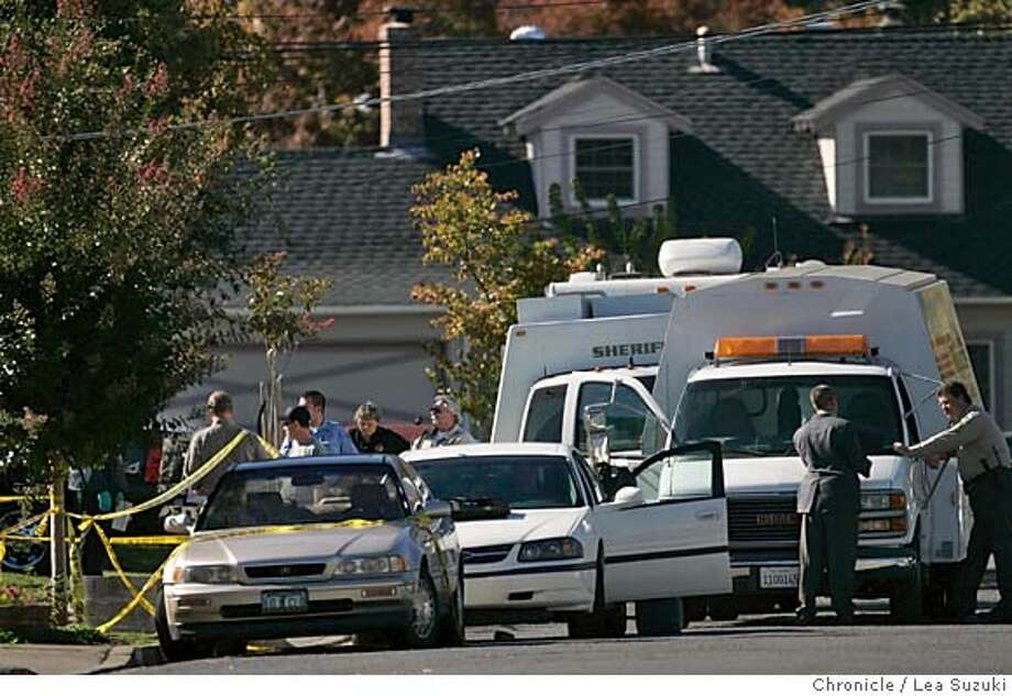 NAPA064_ls.jpg  Investigators and other officials work in front of the home of a double homicide on Dorset St. in Napa. Two women in their 20's slain in their home in Napa. Third woman who lived there woke up, heard the struggle and got away. Killer hasn't been caught. City:� SF, CA  Location:� Hilton Hotel  O'Farrell betw Taylor and Mason Photo taken on 11/1/04 in napa, CA.  Lea Suzuki/ San Francisco Chronicle MANDATORY CREDIT FOR PHOTOG AND SF CHRONICLE/ -MAGS OUT Metro#Metro#Chronicle#11/2/2004#ALL#5star##0422444742 Photo: Lea Suzuki