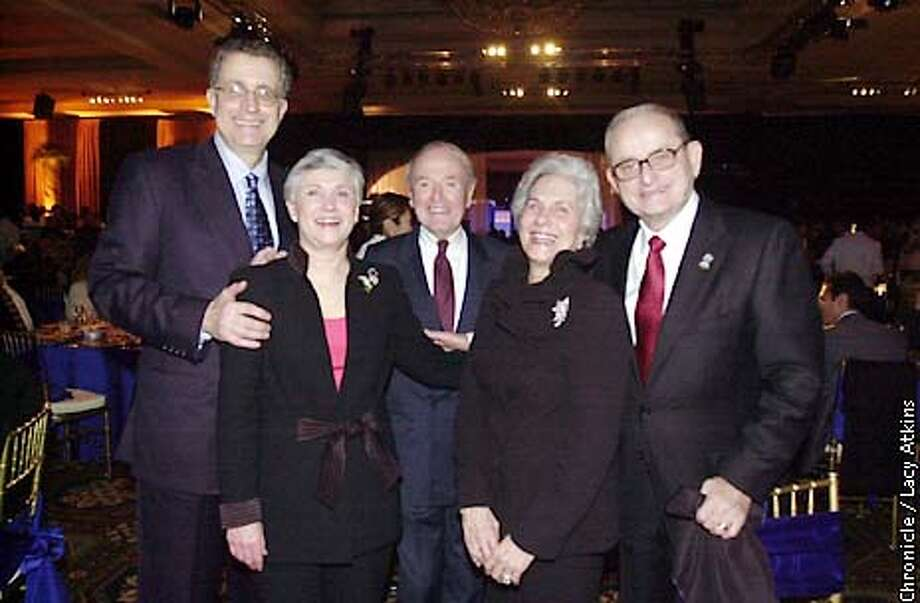.jpg From left: NFL Commisioner Paul Tagliabue and his wife Chan, Roger Woolley and Alex Spanos with his wife Faye attend Spanos Superbowl party at the Manchester Grand Hyatt in San Diego, Ca. Tuesday January 21, 2003. The Oakland Raiders play the Tampa Bay Buccaneers in the Super Bowl in San Diego, Ca. Sunday January 26, 2003. Lacy Atkins/San Francisco Chronicle Photo: Lacy Atkins