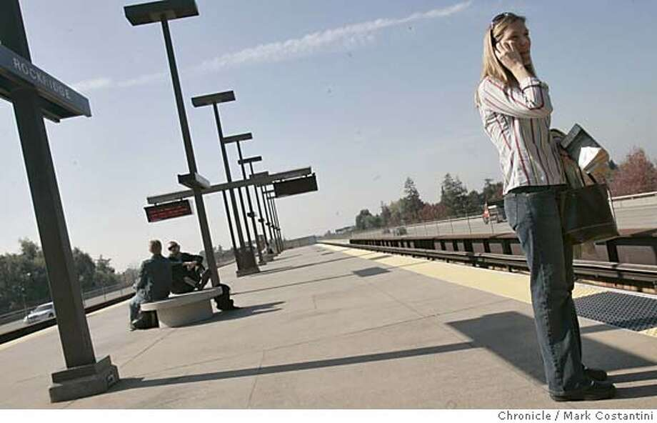 Ani Thompkins, who did not want to give her phone number but will call the reporter after 5pm to speak to him about the Bart Bond, waits for a train at the Rockridge station. Voters in Alameda, Contra Costa, and sf countie are asked to approve a $980 million bond measure to help pay for bolster BART's transbay tube, elevated tracks and an assorment of bldgs against a major earthquake, and ensure it could keep running.  Event in Ooakland on 11/02/04  {Mark Costantini} / {SF CHRONICLE} MANDATORY CREDIT FOR PHOTOG AND SF CHRONICLE/ -MAGS OUT Metro#MainNews#Chronicle#11/03/2004#ALL#Advance#B9#0422446403 Photo: Mark Costantini