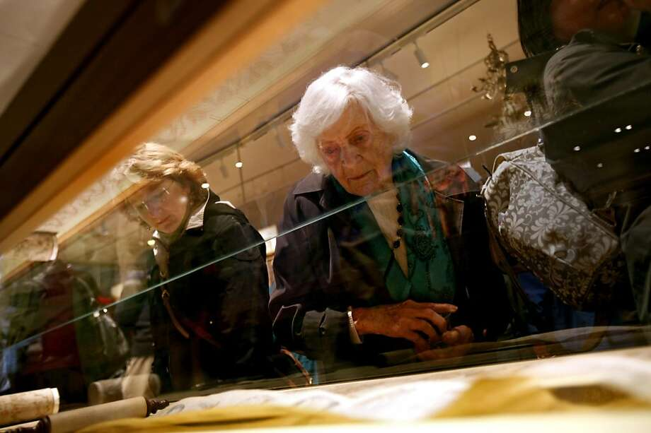 Esther Levy, of Albany, takes in the displays at the re-opening of Magnes Museum in Berkeley, Calif., Sunday, January 22, 2012. Photo: Sarah Rice, Special To The Chronicle