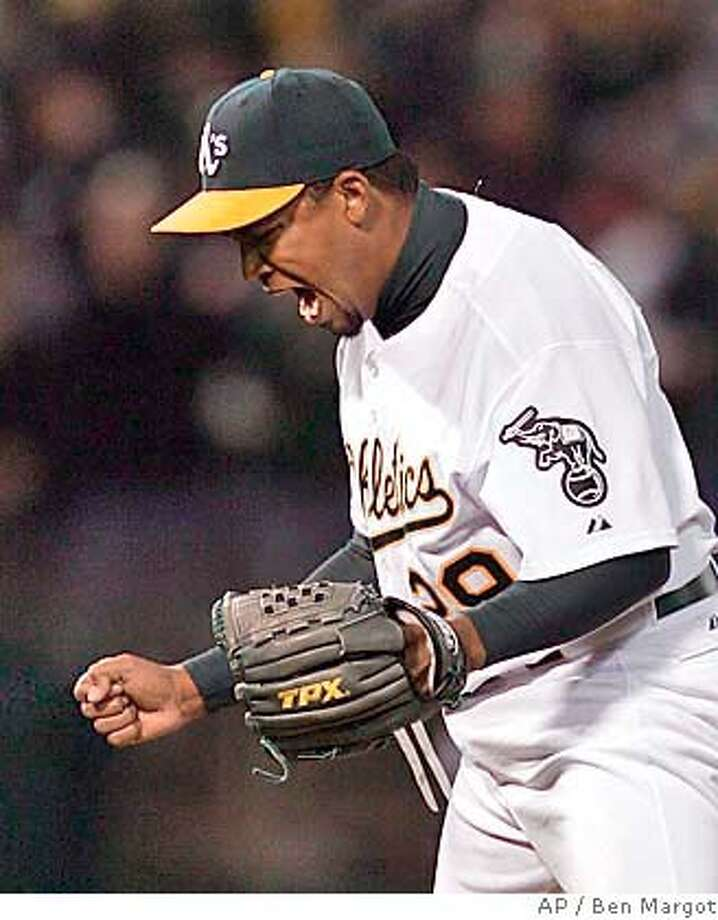 Oakland Athletics pitcher Octavio Dotel reacts after the Athletic's defeated the Chicago White Sox Tuesday, April 26, 2005, in Oakland, Calif. The Athletics won, 9-7, snapping the White Sox eight-game winning streak. (AP Photo/Ben Margot) Photo: BEN MARGOT