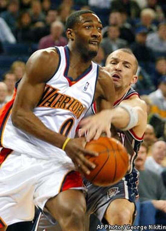 Golden State Warriors' Gilbert Arenas, left, is guarded by New Jersey Nets' Jason Kidd in the first half at the Arena in Oakland, Calif. Thursday, Jan. 23, 2003, in Oakland, Calif. (AP Photo/George Nikitin) Photo: GEORGE NIKITIN