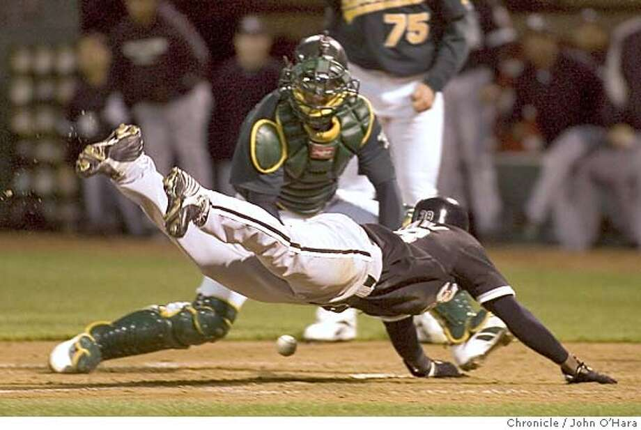 McAfee Coliseum, Oakland, Calif.  Athletics V/S Boston White Sox  #38, Pablo Ozuna dives towards home plate after #8 Carl Everett hit a triple. The A's catcher , Jason Kendall fielded the throw to home plate. The ball bounced off his glove. Ozuna was safethe score now 4/0 Boston  Photo/ John O'Hara Photo: John O'hara