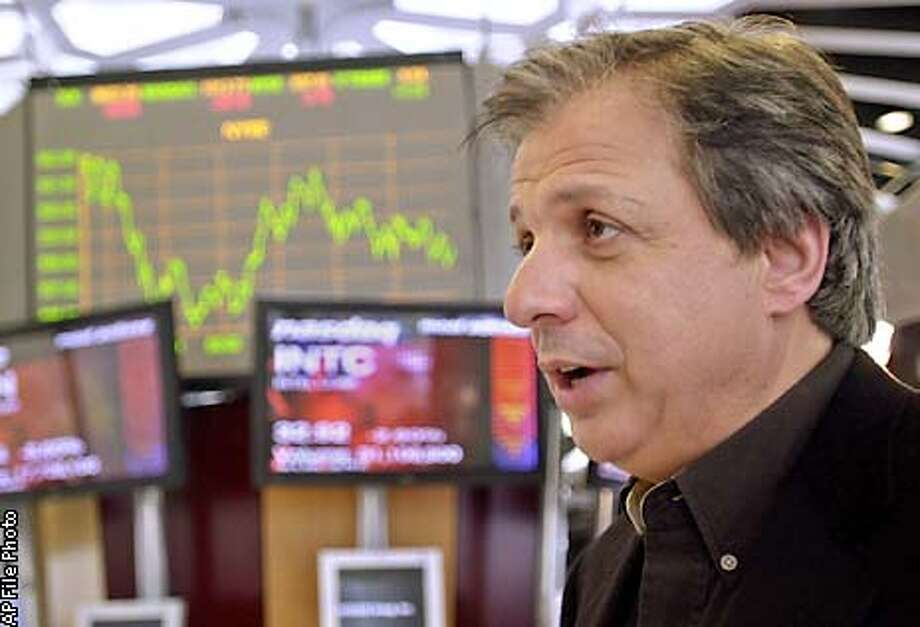 ** FILE ** ETrade Group Inc. CEO Christos Cotsakos speaks during an interview Wednesday, Feb. 6, 2002, at ETrade offices in San Francisco. Christos Cotsakos has resigned as chairman and C-E-O as well as director of E-Trade the company said Friday Jan. 24, 2003. His departure comes days after the online brokerage company issued a gloomy earnings forecast for 2003 and after sharp criticism of Cotsakos' compensation. (AP Photo/Ben Margot) Photo: BEN MARGOT