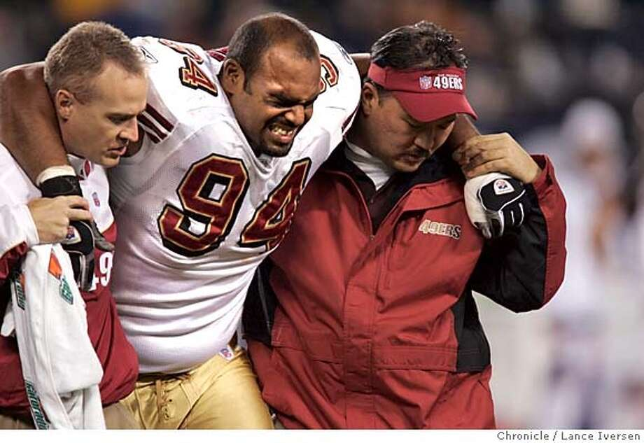 49ers_345.jpg_  Niners #94 Brandon Whiting is helped off the field after suffering what appears to be a knee injury in first half action. San Francisco 49ers vs. The Chicago Bears. By Lance Iversen/San Francisco Chronicle MANDATORY CREDIT PHOTOG AND SAN FRANCISCO CHRONICLE. Sports#Sports#Chronicle#11/1/2004#ALL#5star##0422443328 Photo: Lance Iversen