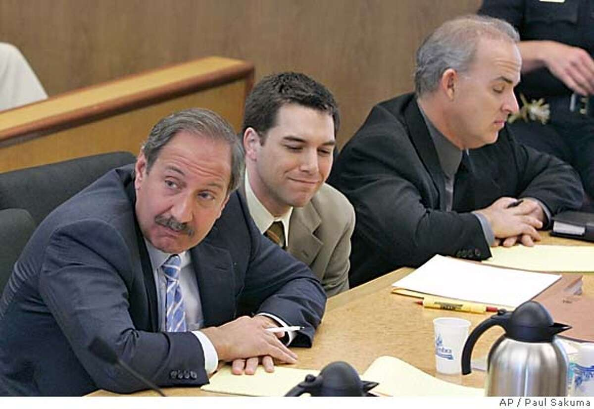 Defense attorney Mark Geragos, left, Scott Peterson, center, and defense attorney Pat Harris listen during the prosecutions closing arguments in Redwood City, CA Monday November 1, 2004. Prosecutors urged jurors Monday to convict Peterson of murdering his pregnant wife, saying his own statement that he was out fishing near where her body later turned up is a fact