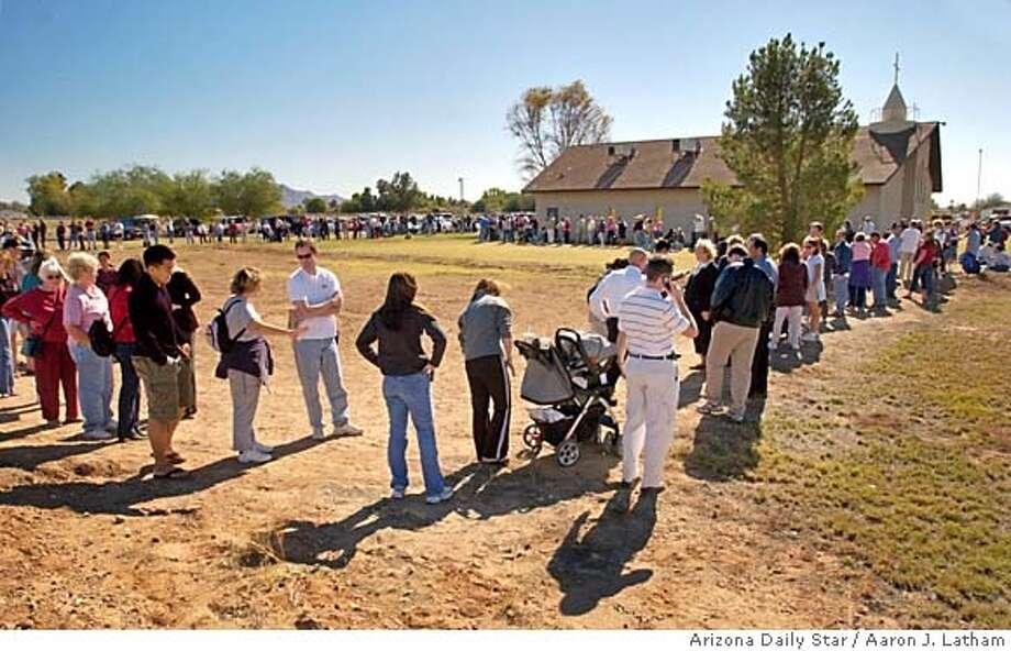 Chandler, Ariz. residents wait in line to vote at McQueen Road Baptist Church on Tuesday November 2, 2004. With hundreds in line at this precinct in the middle of booming south Chandler, the wait was around four hours. MAGS OUT/ /MANDATORY CREDIT. Photo by Aaron J. Latham/Arizona Daily Star. Photo: Aaron J. Latham