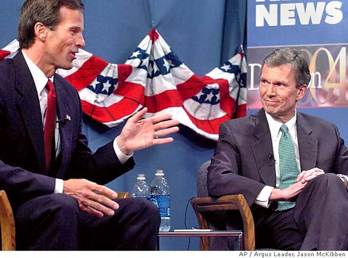 Sen. Tom Daschle, D-S.D., right, listens as former Rep. John Thune, R-S.D., talks about constitutional amendments during a televised debate Tuesday, Oct. 12, 2004, in Sioux Falls, S.D. (AP Photo/Argus Leader, Jason McKibben) Ran on: 11-01-2004 Sen. Tom Daschle (right) listens as his challenger, former Republican Rep. John Thune, speaks in Sioux Falls, S.D. Ran on: 11-01-2004 Sen. Tom Daschle (right) listens as his challenger, former Republican Rep. John Thune, speaks in Sioux Falls, S.D.