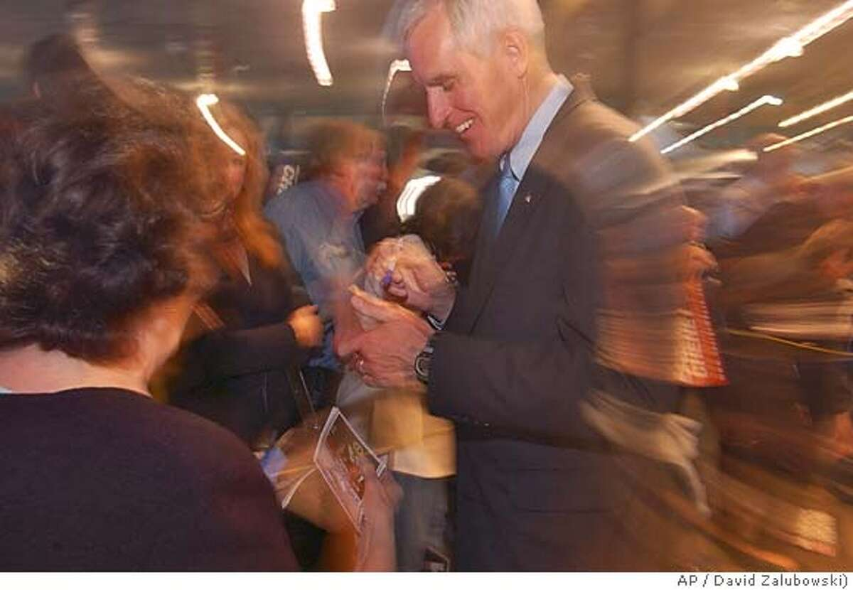 Republican Pete Coors signs an autograph for a supporter after a rally with former President George Bush on Thursday, Oct. 28, 2004, at Wings Over the Rockies Museum in east Denver. Coors, scion to the brewing company founded by his family in Golden, Colo., is facing Democrat Ken Salazar, the state's attorney general, for the vacant U.S. Senate seat. (AP Photo/David Zalubowski)