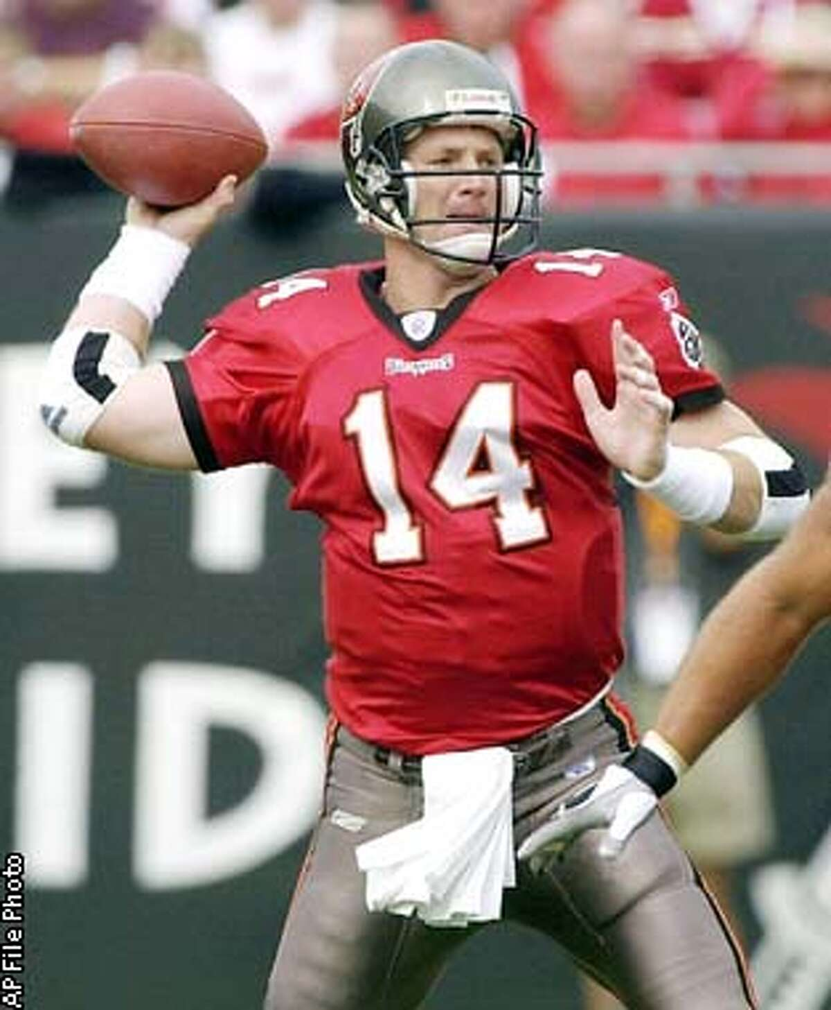 Tampa Bay Buccaneers quarterback Brad Johnson throws against the San Francisco 49ers' in the first quarter of the NFC Divisional playoff Sunday, Jan. 12, 2003, in Tampa, Fla. As well as they're playing and as confident as the Bucs are, they will have to buck some serious trends to reach the Super Bowl: 0-2 vs. the Eagles in the playoffs the past two years, 0-6 on the road in franchise postseason history, and 1-21 when the temperature is 40 or below.(AP Photo/Chris O'Meara)