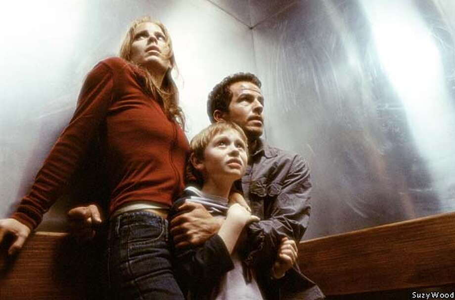 "Emma Caulfield, Lee Cormie and Chaney Kley take cover from the Tooth Fairy in the horror movie ""Darkness Falls."" Publicity photo by Suzy Wood"