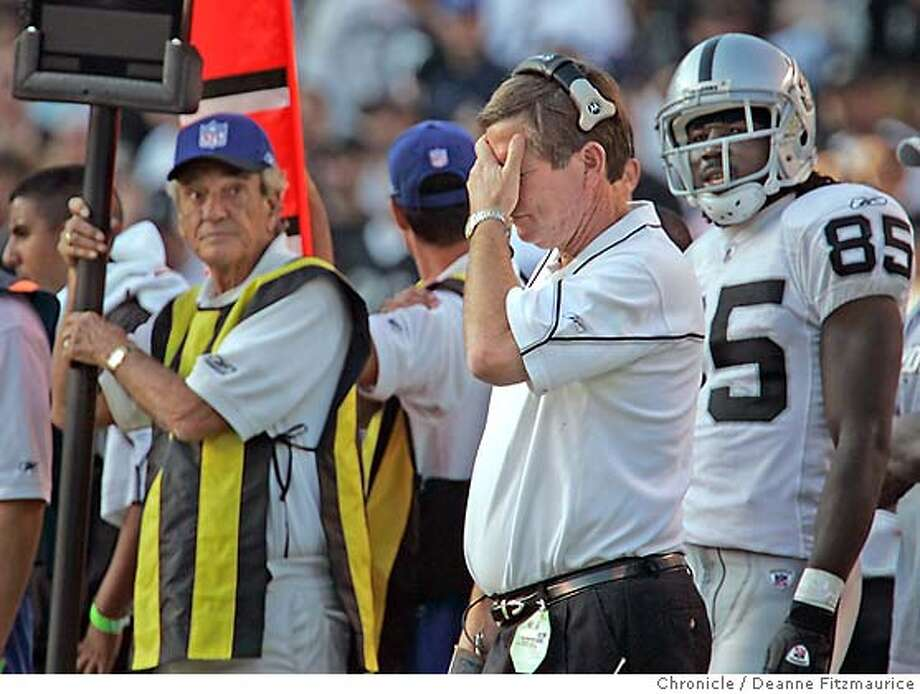 Head coach Norv Turner covers his face after the Chargers score another touchdown late in the game. Chargers won 42-14. Oakland Raiders vs San Diego Chargers at Qualcomm Stadium in San Diego.  Deanne Fitzmaurice / The Chronicle Photo: Deanne Fitzmaurice