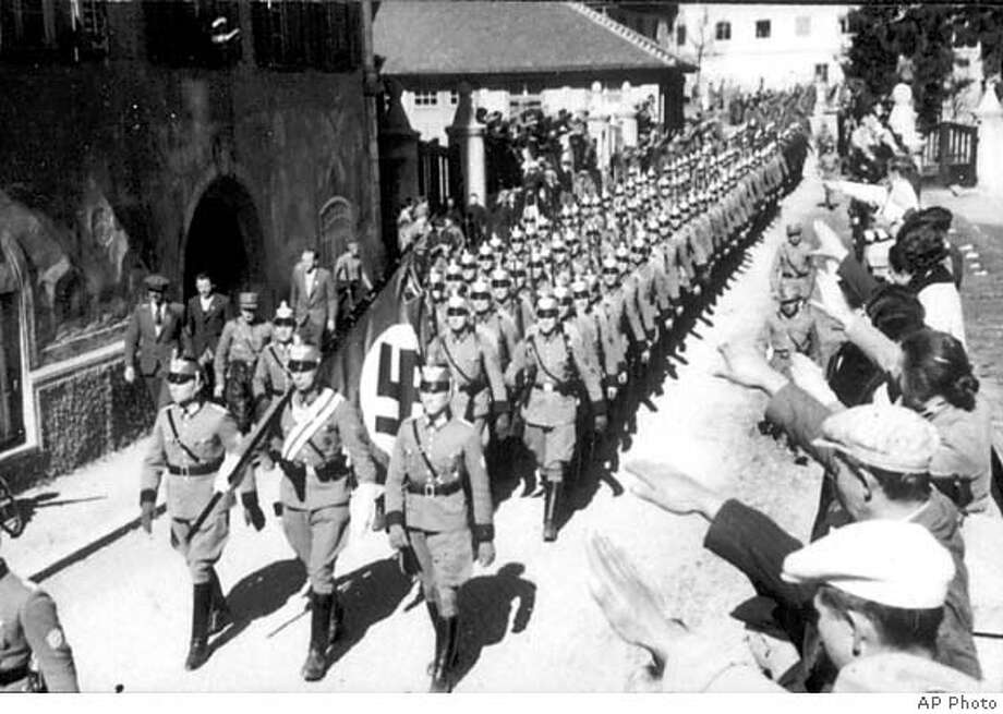 A formation of German Police is seen entering the Austrian city of Imst on March 12, 1938, as Austria is incorporated into Germany as part of the Third Reich. (AP Photo)