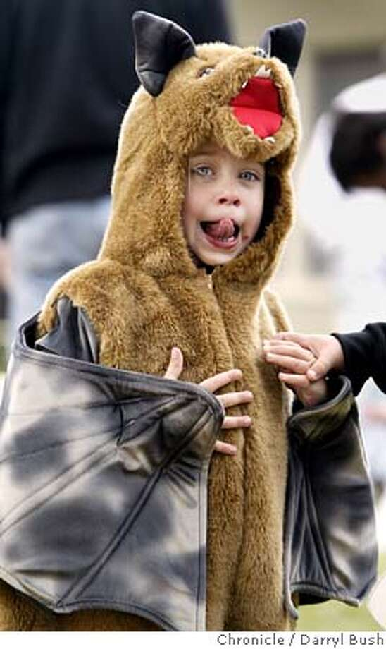halloween_005_db.jpg  Elise Hudson, 3, of San Francisco, dressed as a fruit bat plays like a bat during outdoor activities at Family Halloween Day at the Randall Museum.  10/30/04 in San Francisco  Darryl Bush / The Chronicle MANDATORY CREDIT FOR PHOTOG AND SF CHRONICLE/ -MAGS OUT Metro#Metro#Chronicle#10/31/2004#ALL#5star##0422441408 Photo: Darryl Bush