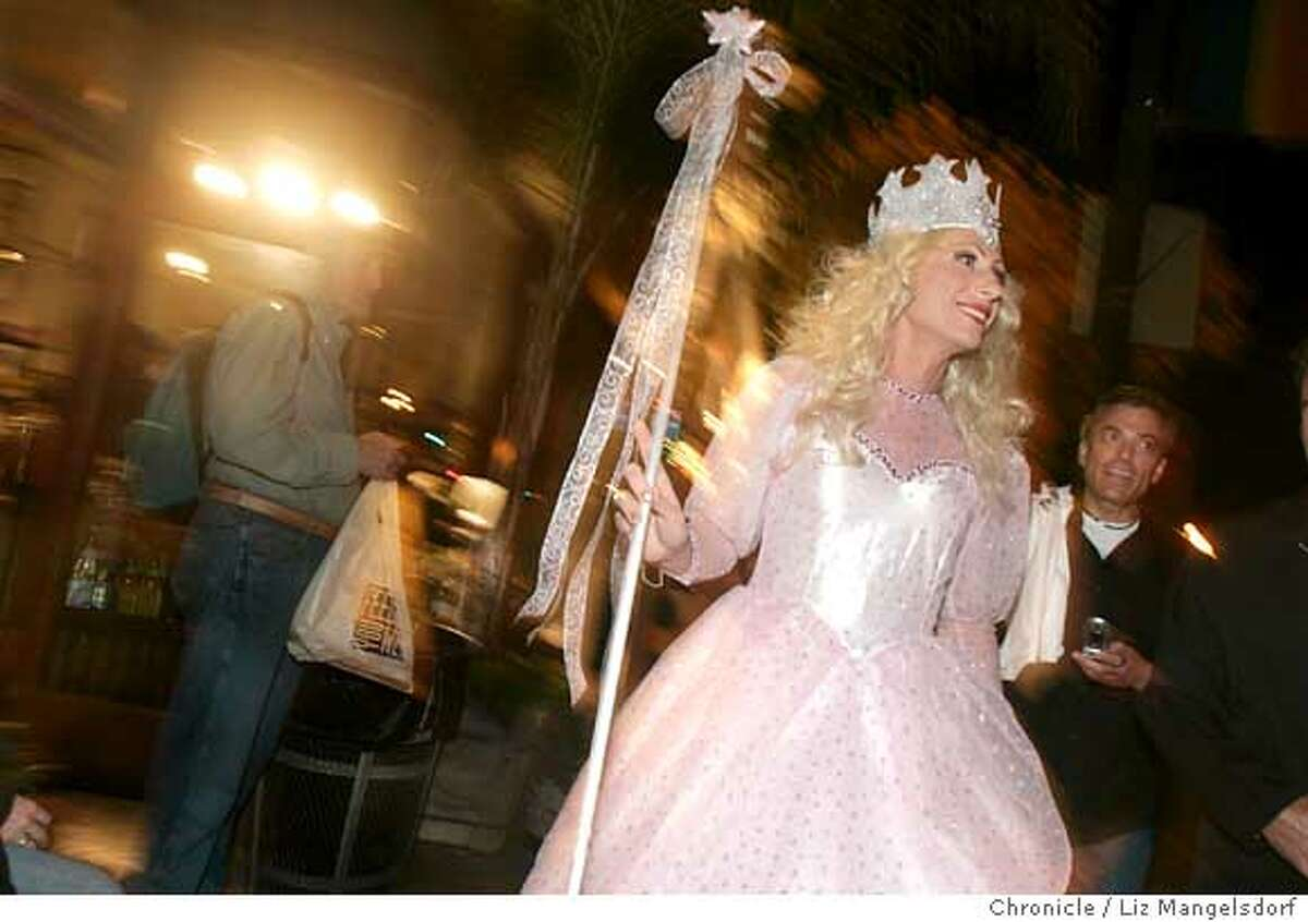 Event on 10/31/04 in San Francisco. Empress Donna Sachet, (only name given) walks down Market Street as the festivities get under way. The Castro on halloween night. Liz Mangelsdorf / The Chronicle