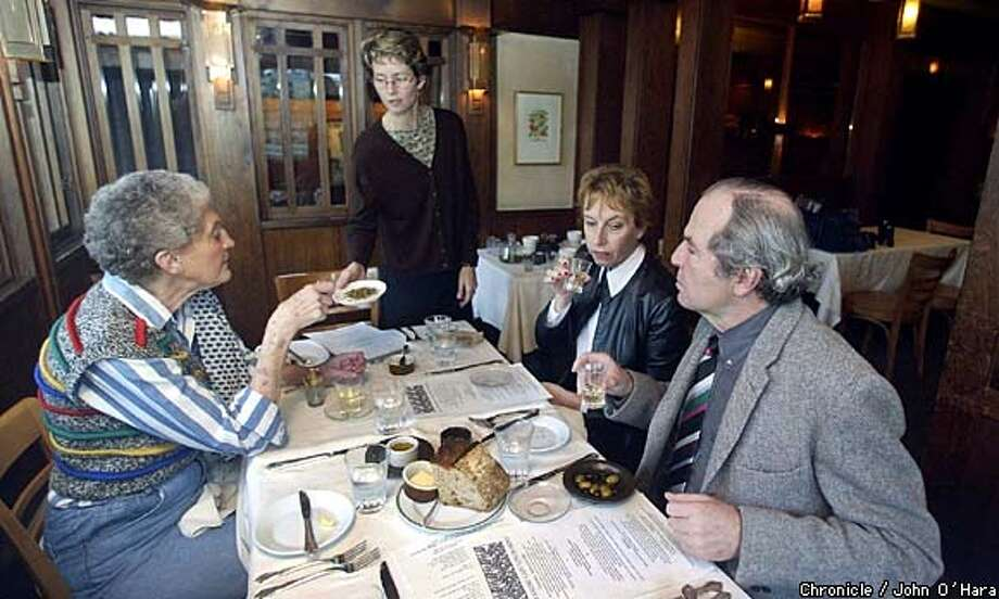 At Chez Panisse, James Norwood Pratt (right), has lunch and tea with Helen Gufstason (from left), Alice Cravens and Valerie Turner. Chronicle photo by John O'Hara