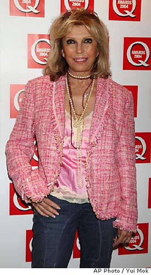 Nancy Sinatra arrives for the 15th annual music magazine Q Awards at Grosvenor House in London's Park Lane Monday Oct.4, 2004. The Q awards are given in recognition to the best of the music industry. (AP Photo / Yui Mok, PA) ** UNITED KINGDOM OUT MAGS OUT ** UNITED KINGDOM OUT MAGS OUT Datebook#Datebook#SundayDateBook#10-31-2004#ALL#Advance##0422393535 Photo: YUI MOK