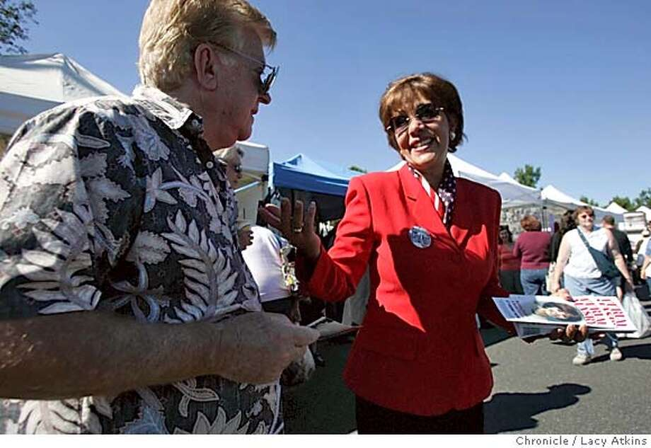 Ferial Masry, right, talks to Chuck Kuenstle at a street fair while campaigning, Sunday Oct. 31, 2004, in Thousand Oaks. Democratic candidate Ferial Masry is making a strong showing in a district represented by one of the most conservative Republicans in the Assembly, Thousand Oaks, Ca. Oct. 31,2004. LACY ATKINS/SAN FRANCISCO CHRONICLE Metro#MainNews#Chronicle#11/01/2004#ALL#5star##0422442637 Photo: LACY ATKINS