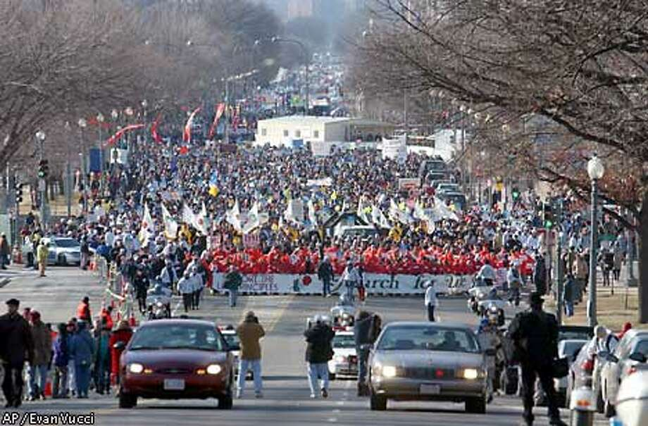 Thousands of anti-abortion demonstrators make their way up Constitution Avenue in Washington in the annual March for Life rally. Associated Press photo by Evan Vucci