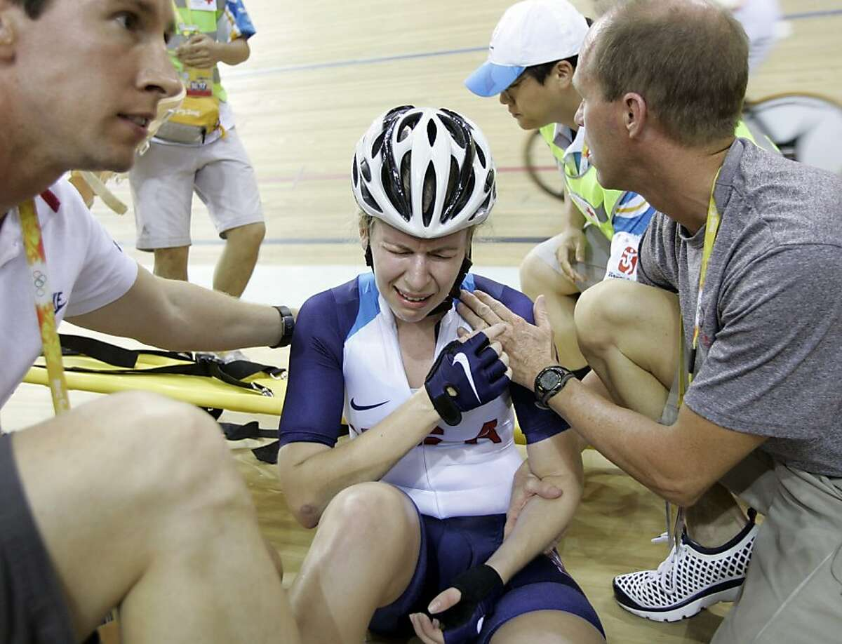 United States' Sarah Hammer grimaces in pain after crashing during the Track Cycling Women's Points Race, at the Beijing 2008 Olympics in Beijing, Monday, Aug. 18, 2008.
