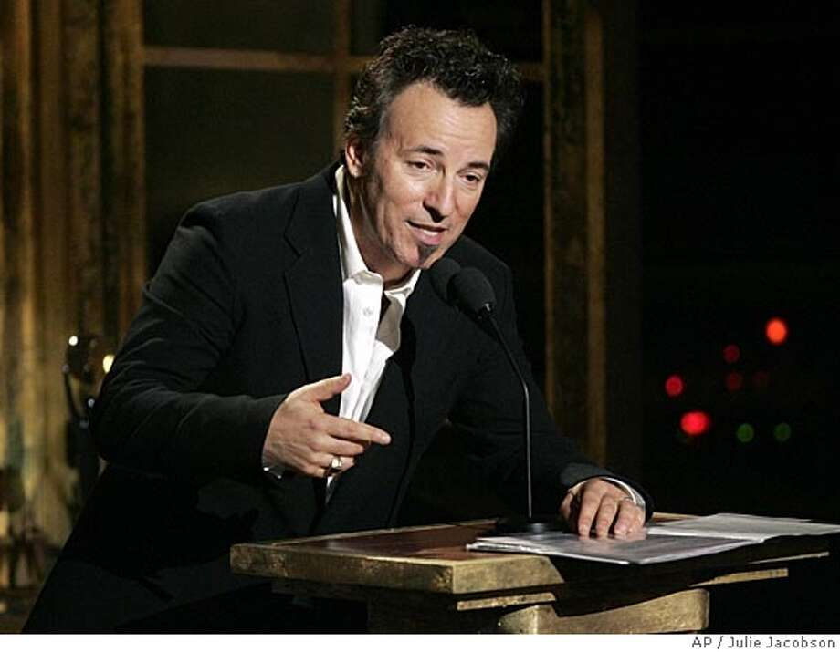 """**FILE** Bruce Springsteen speaks at the Rock and Roll Hall of Fame induction ceremony in this Monday, March 14, 2005 file photo in New York. Some 350 people at The Two River Theatre watched The Boss perform during a taping of VH1's """"Storytellers"""" series Monday night in Red Bank, NJ. (AP Photo/Julie Jacobson, File) A MARCH 14, 2005 FILE PHOTO Photo: JULIE JACOBSON"""