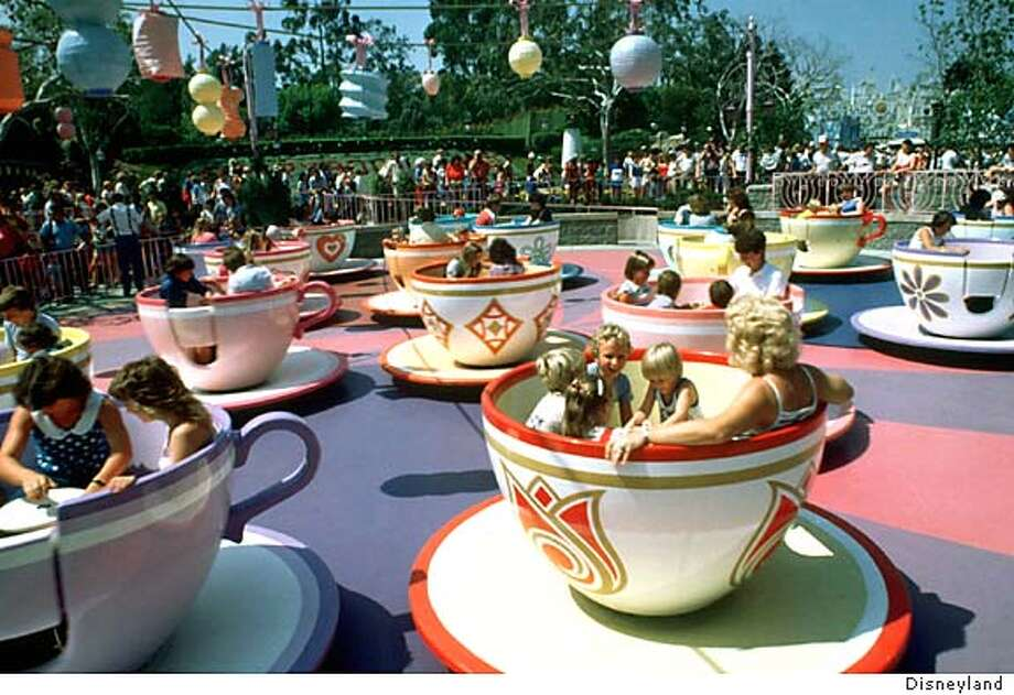 TRAVEL DISNEYLAND -- The Mad Tea Party ride will get back some of its old gut-wrenching twists and turns as it and other Disneyland rides return to their roots in preparation for the park's 50th anniversary celebration next year. Credit: Courtesy of Disneyland Travel#Travel#Chronicle#10/31/2004#ALL#Advance##0422435632