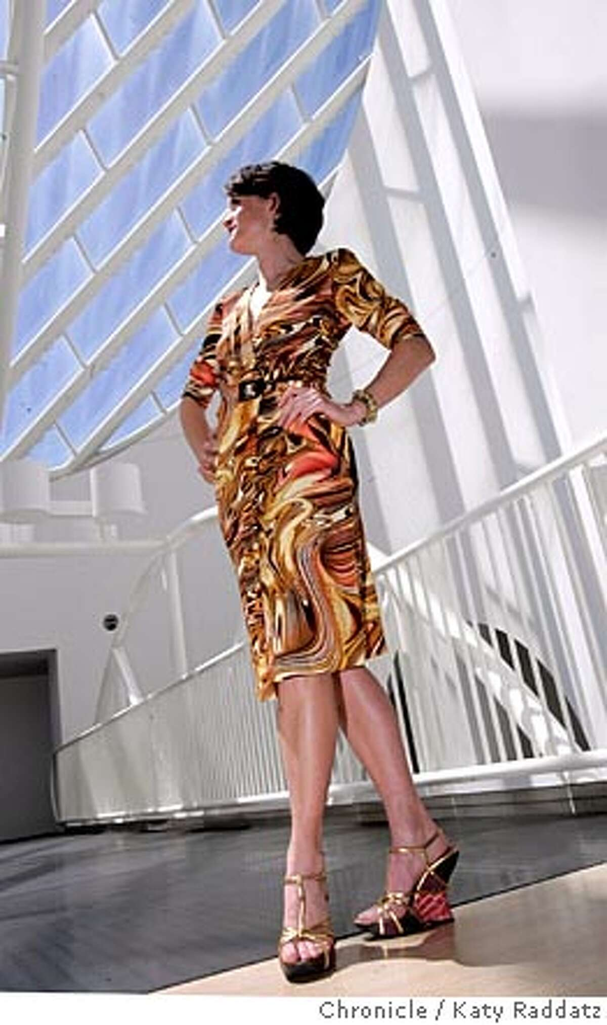 STYLEMATTERS24011_RAD.JPG Advance story for the big MOMA Modern Ball at the San Francisco Museum of Modern Art. SHOWN: Amanda Michael (cq) Gamble modeling her lovely Escada tiger eye patterned wrap dress with her lovely Prada gold platform wedge shoes. Amanda stands on the fifth floor bridge with the famous museum skylight behind her. Photo taken on 4/18/05, in SAN FRANCISCO, CA. By Katy Raddatz / The San Francisco Chronicle MANDATORY CREDIT FOR PHOTOG AND SF CHRONICLE/ -MAGS OUT